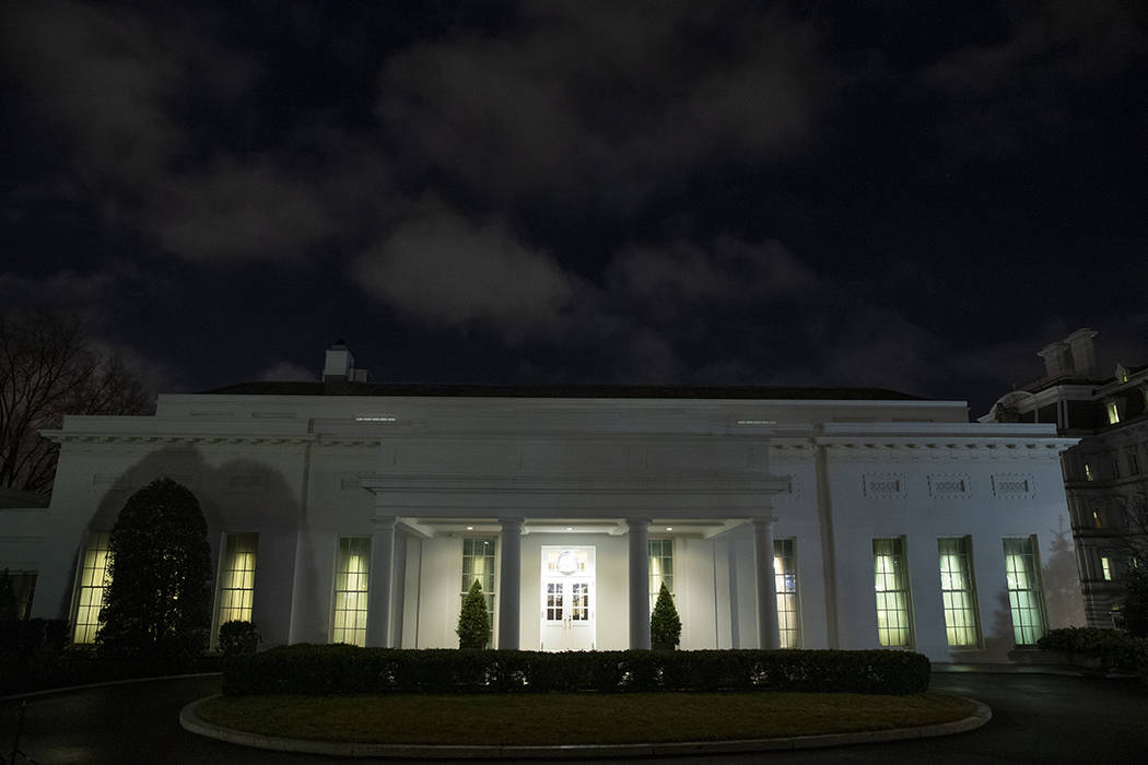All the lights are on in the windows of the West Wing of the White House after news of a missil ...