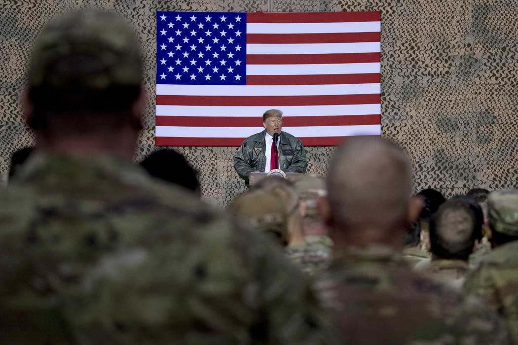 FILE - In this Dec. 26, 2018, file photo, President Donald Trump speaks to members of the milit ...
