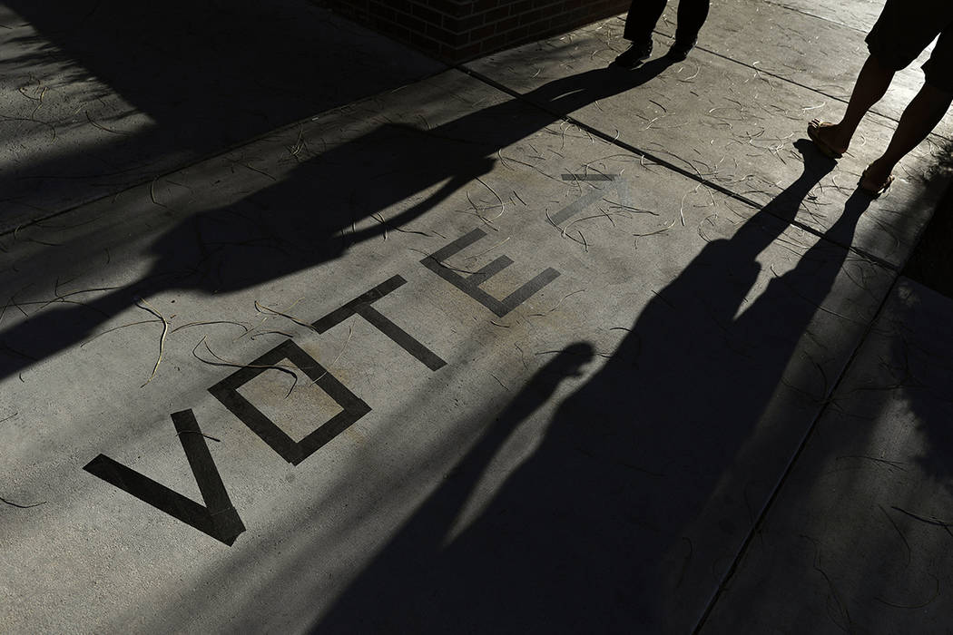 In this Nov. 6, 2018 file photo, voters head to the polls at the Enterprise Library in Las Vega ...