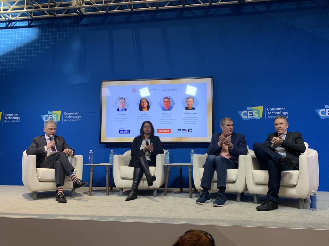 Andrei Iancu and Rini Paiva discuss technology with inductees Mick Mountz and Raffaello D'And ...