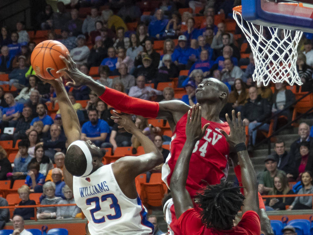 UNLV forward Cheikh Mbacke Diong blocks a shot by Boise State guard RJ Williams but is called f ...
