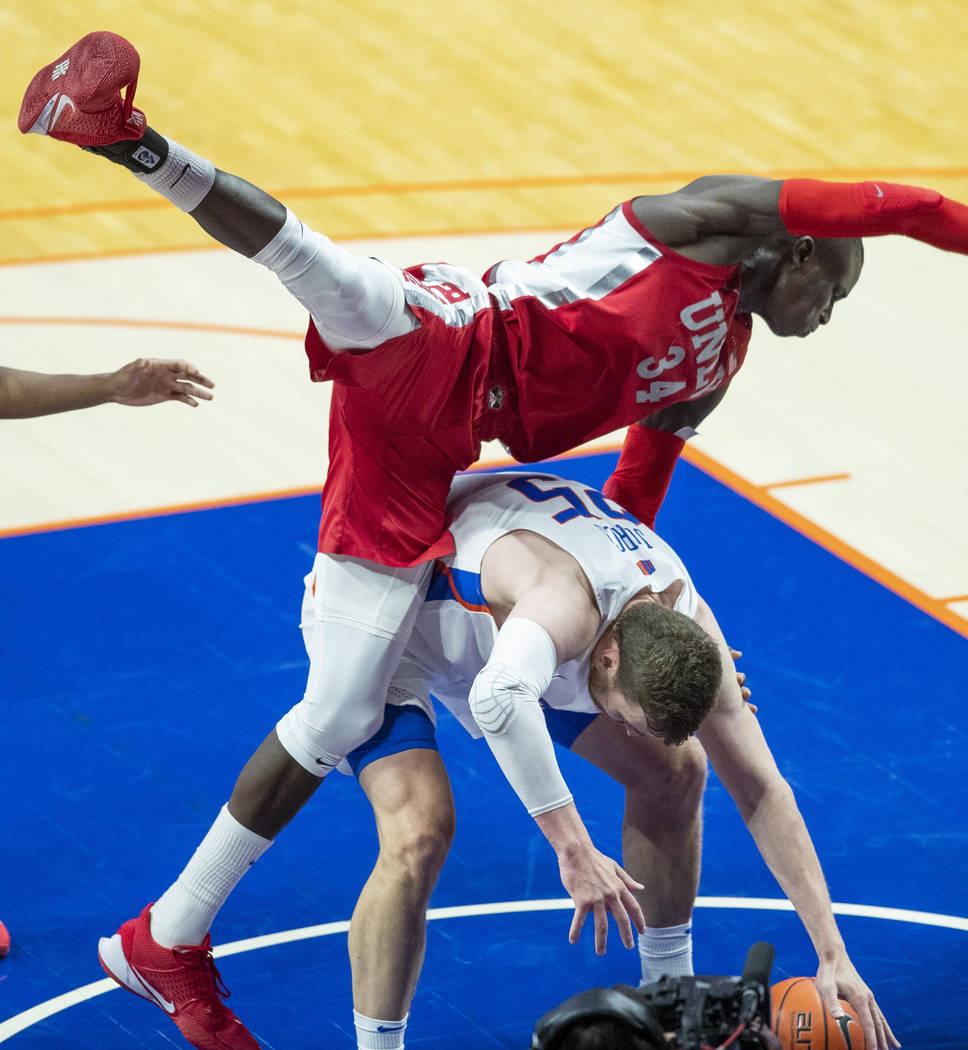 UNLV forward Cheikh Mbacke Diong falls on top of Boise State center Robin Jorch during the seco ...