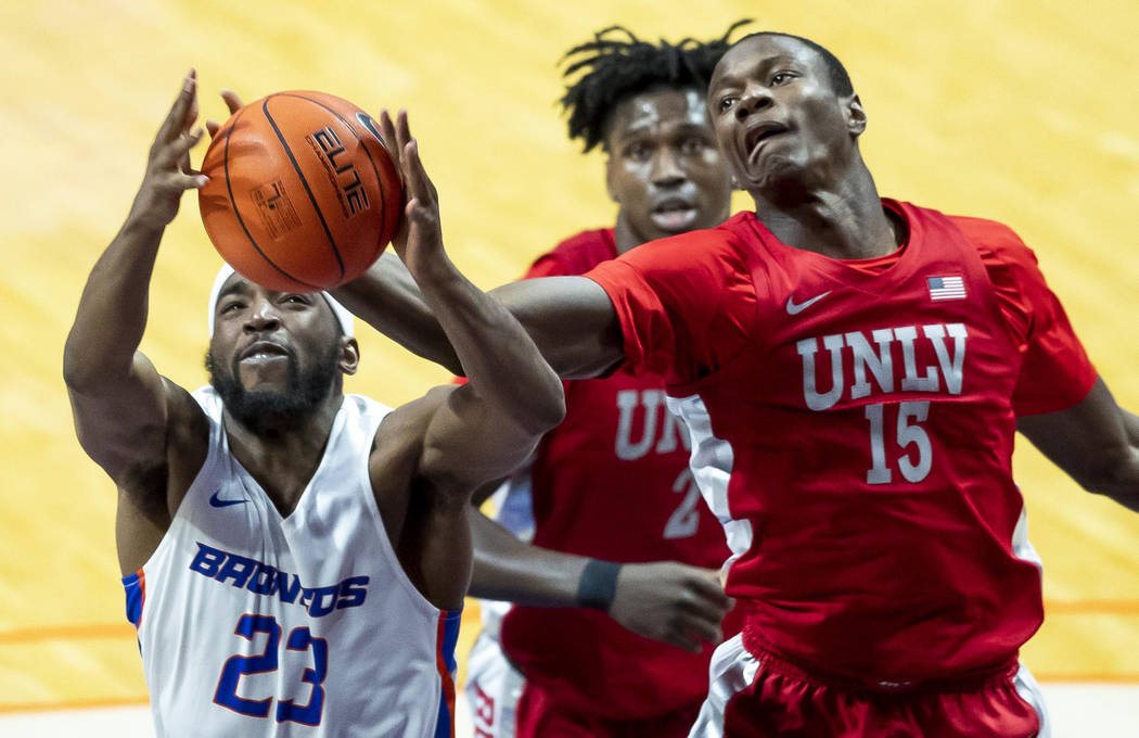Boise State guard RJ Williams fights for a rebound with UNLV forward Cheickna Dembele during th ...