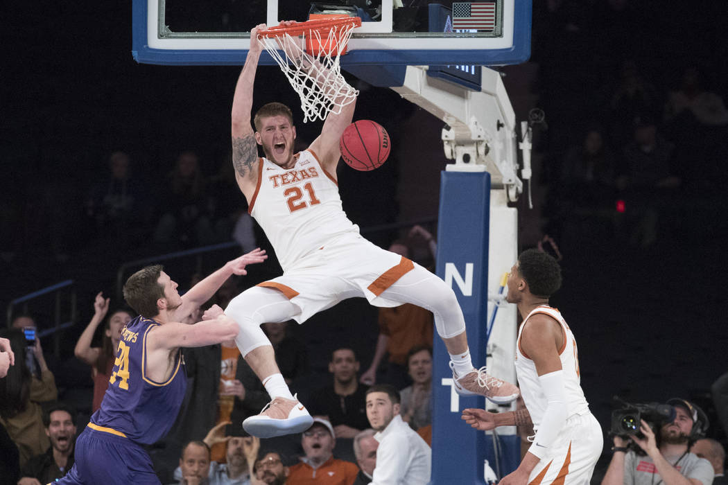 Texas forward Dylan Osetkowski (21) dunks during the second half of the championship basketball ...