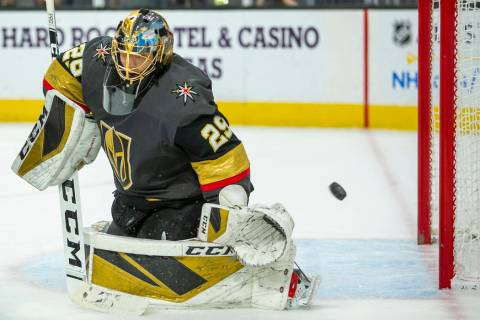 The puck goes past Vegas Golden Knights goaltender Marc-Andre Fleury (29) on a shot by the Pitt ...