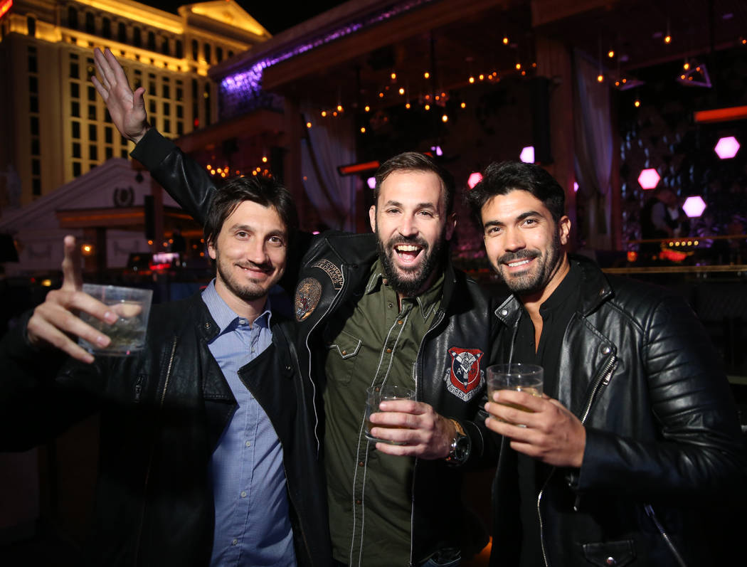 Conventioneers, including, from left, Ariel Rombola, Lucas Genovese and Cristian Zigante of Arg ...