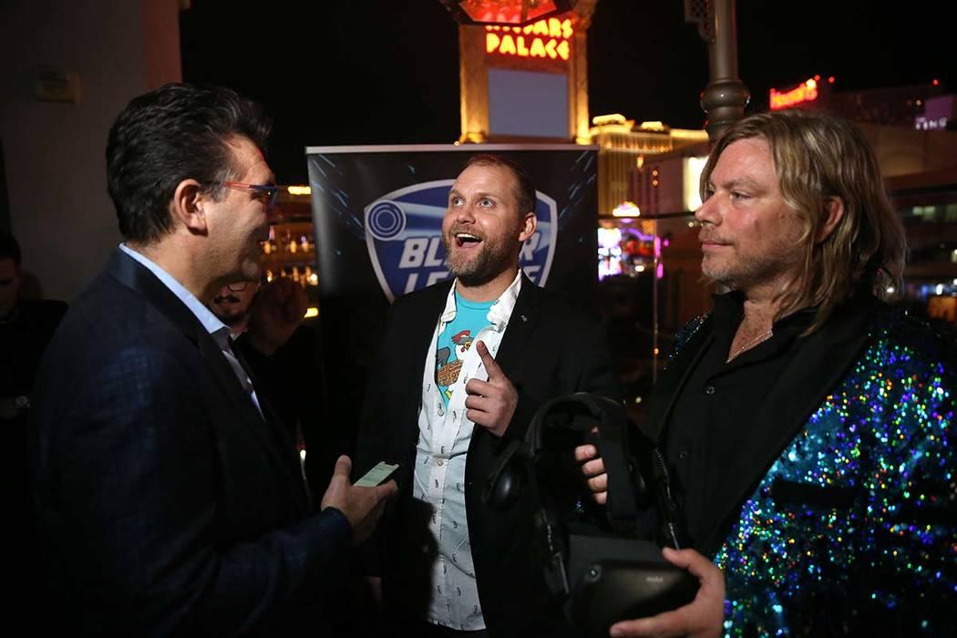 Las Vegas Review-Journal columnist John Katsilometes, left, talks virtual reality Chicken Waffl ...
