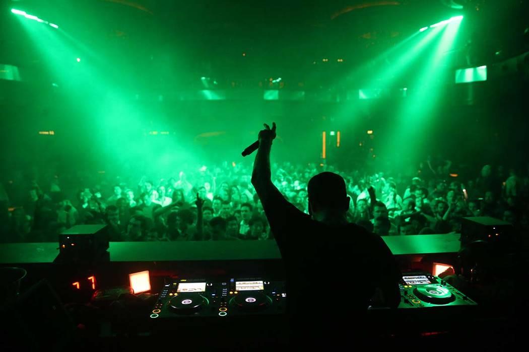 Conventioneers and clubgoers dance to DJ Fergie during the CES 2020 official opening party in t ...