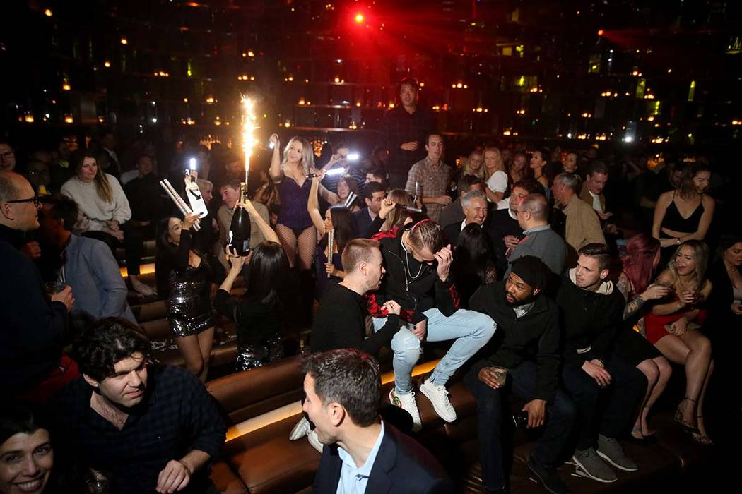 Conventioneers and clubgoers during the CES 2020 official opening party in the Main Room at Omn ...