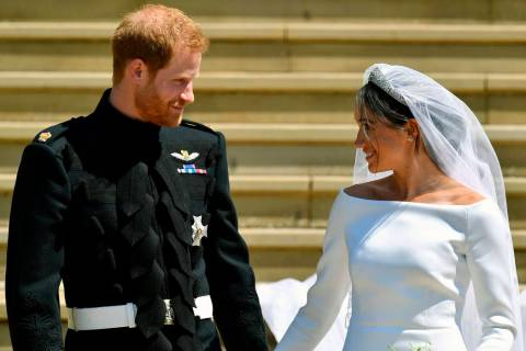FILE - In this Saturday, May 19, 2018 file photo, Britain's Prince Harry and Meghan Markle walk ...