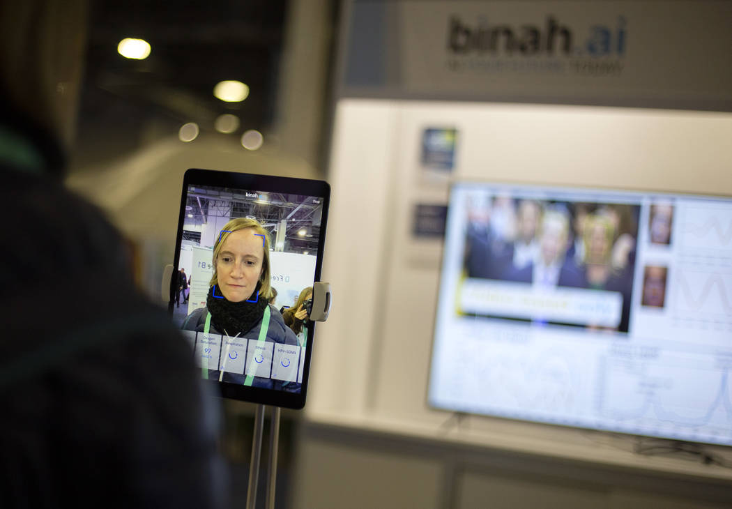 Claire Thelliez of Paris, France tries out the Binah.ai app on Wednesday, Jan. 8, 2020, at CES ...