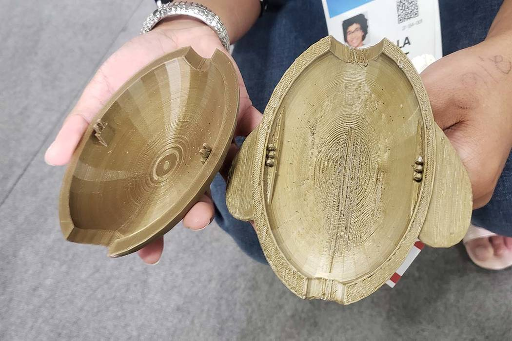 Gabriella Pleasant of Pleasant Robotics shows off Peter, the palm-sized, turtle-shaped device t ...