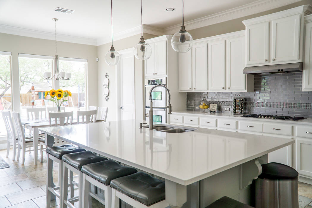 When staging a home for sale, kitchen counters need to be clean and clear of any clutter. Bring ...