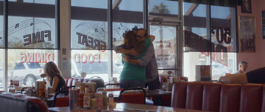 Deanna and John Green share a hug at a diner. (NETFLIX)
