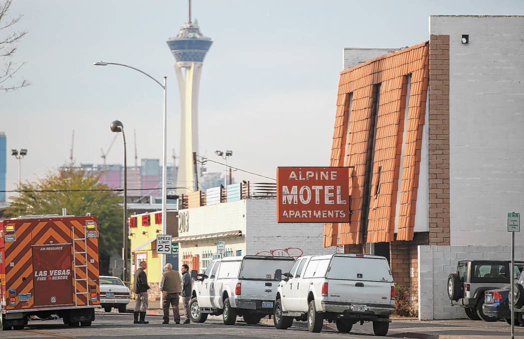 Las Vegas firefighters respond to the scene of a fire at the Alpine Apartment Motel that left 6 ...