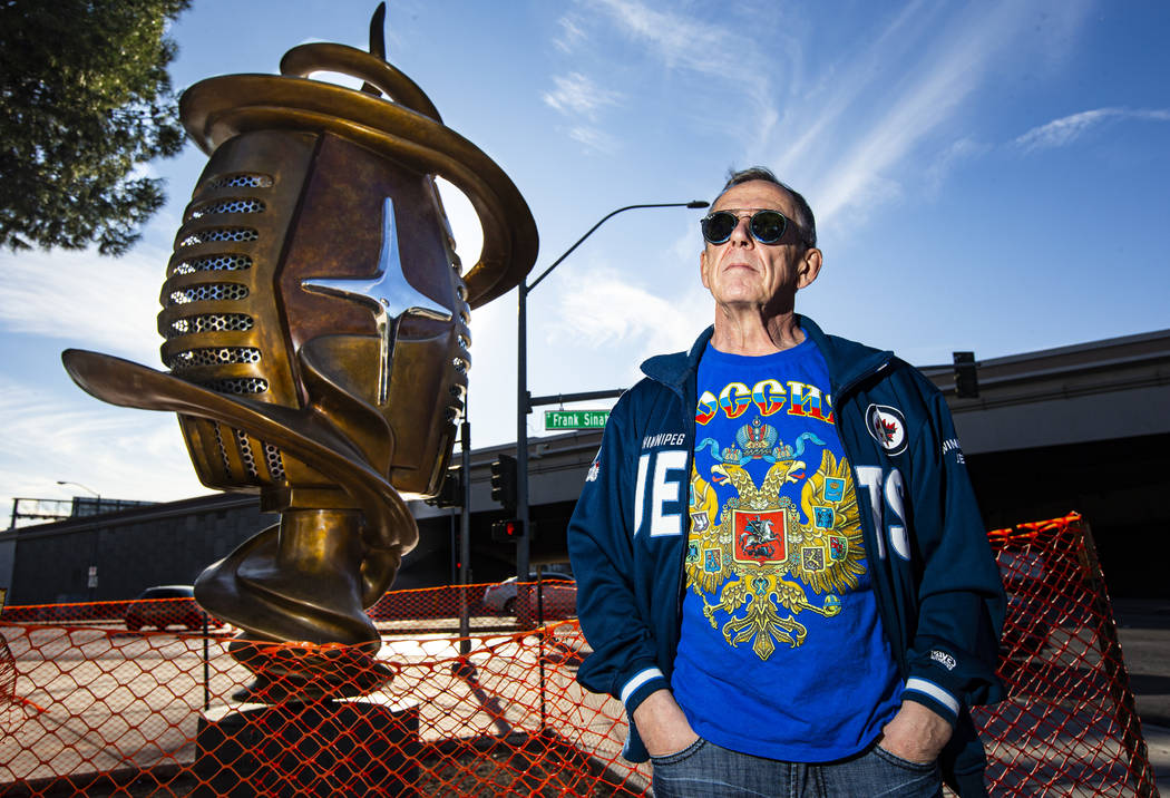 """Artist Wayne Littlejohn poses with his sculpture, """"Spin Baby,"""" at the intersection of ..."""
