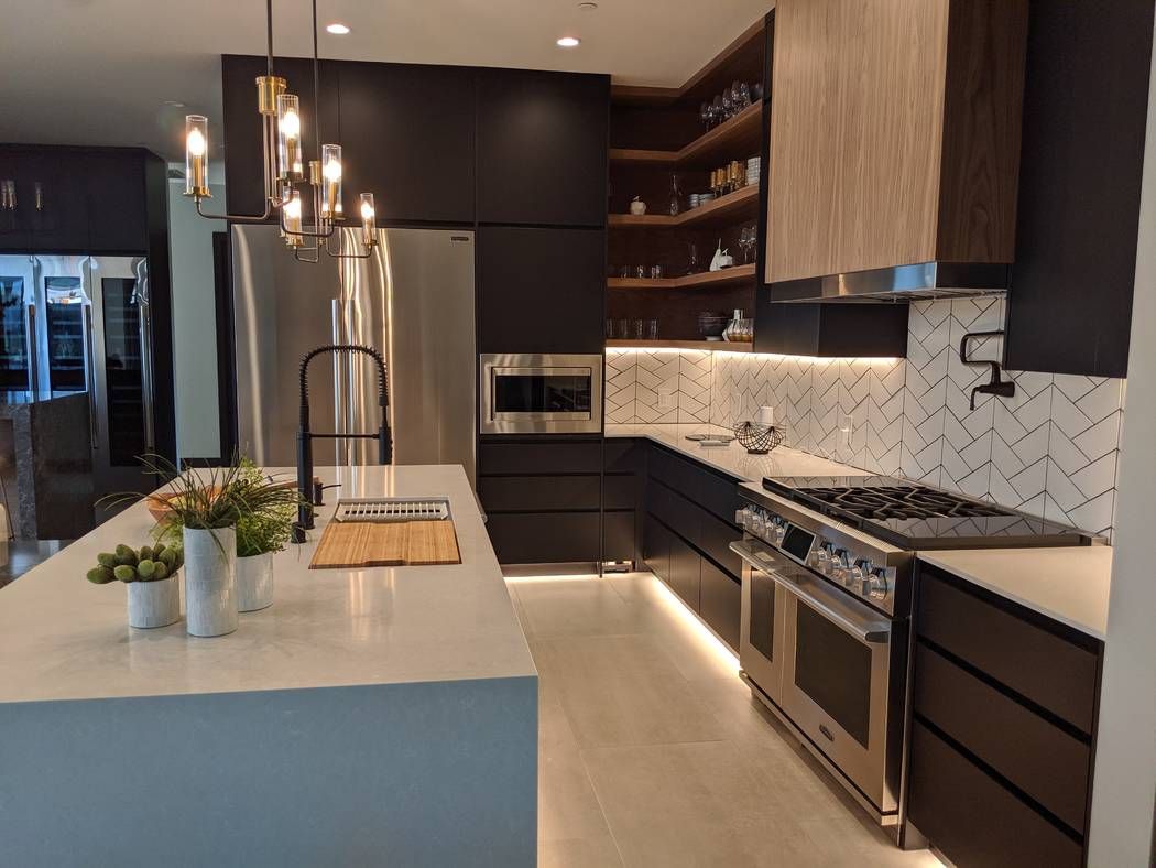 There's a natural walnut accent finish on the kitchen cabinets. (Element Building Co.)