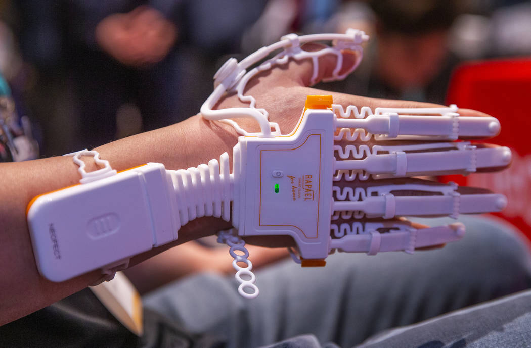 Poh Oh demonstrates the Neofect Smart Glove for injury rehabilitation during Pepcom's Digital E ...