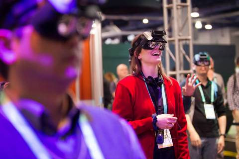 Alyson Lemmer, of Chicago, tries out Realmax virtual reality at CES at the Las Vegas Convention ...