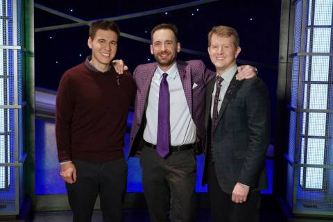 In this image released by ABC, from left, James Holzhauer, Brad Rutter and Ken Jennings appear ...
