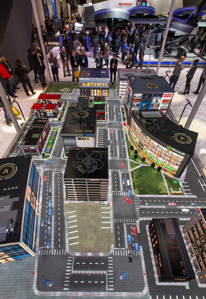 A mock city shows how the new Bell Nexus 4EX air taxi concept's will navigate from place to pla ...