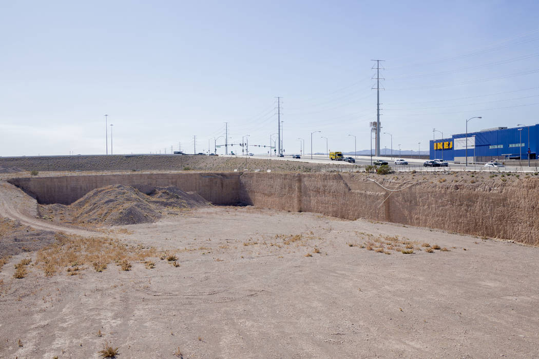 A vacant plot of land on the southeast corner of Sunset Road and Durango Drive is posted for sa ...