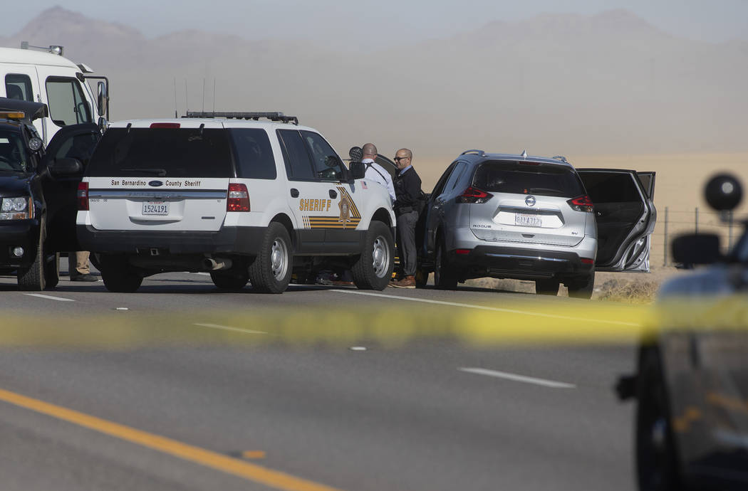 Police investigate the suspect's vehicle in an incident that resulted in the northbound lanes o ...