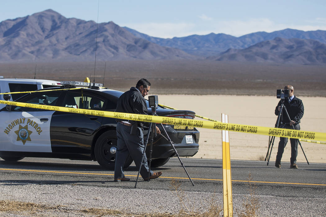 Police work the scene of a fatal officer involved shooting south of Primm on I-15 North, Wednes ...