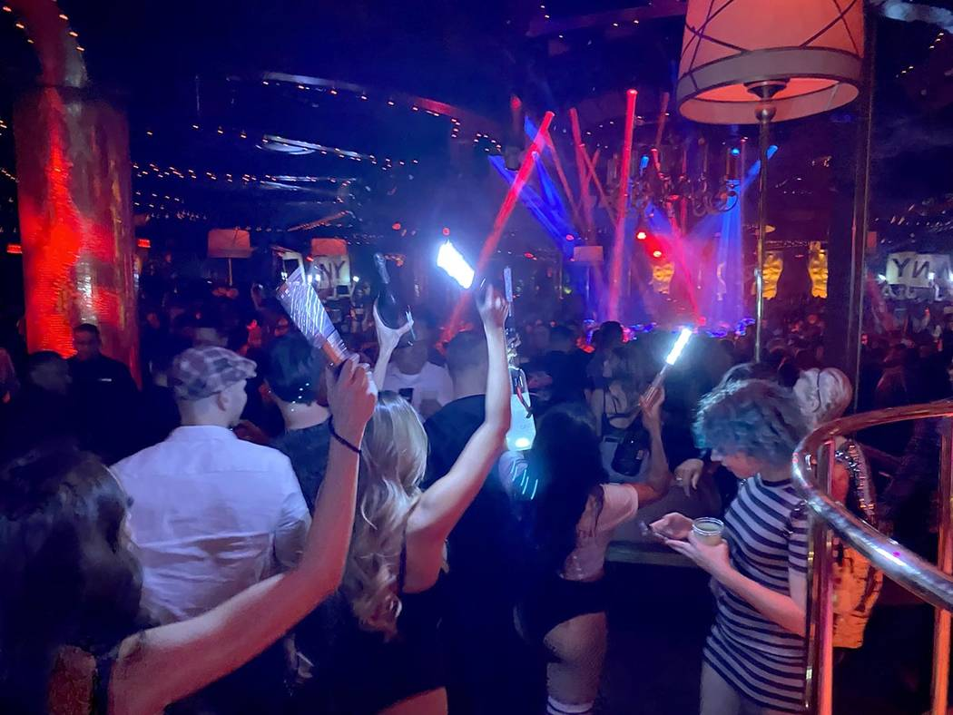 Fans and servers wait for Drake to perform at XS Nightclub at Encore on the Strip in Las Vegas ...