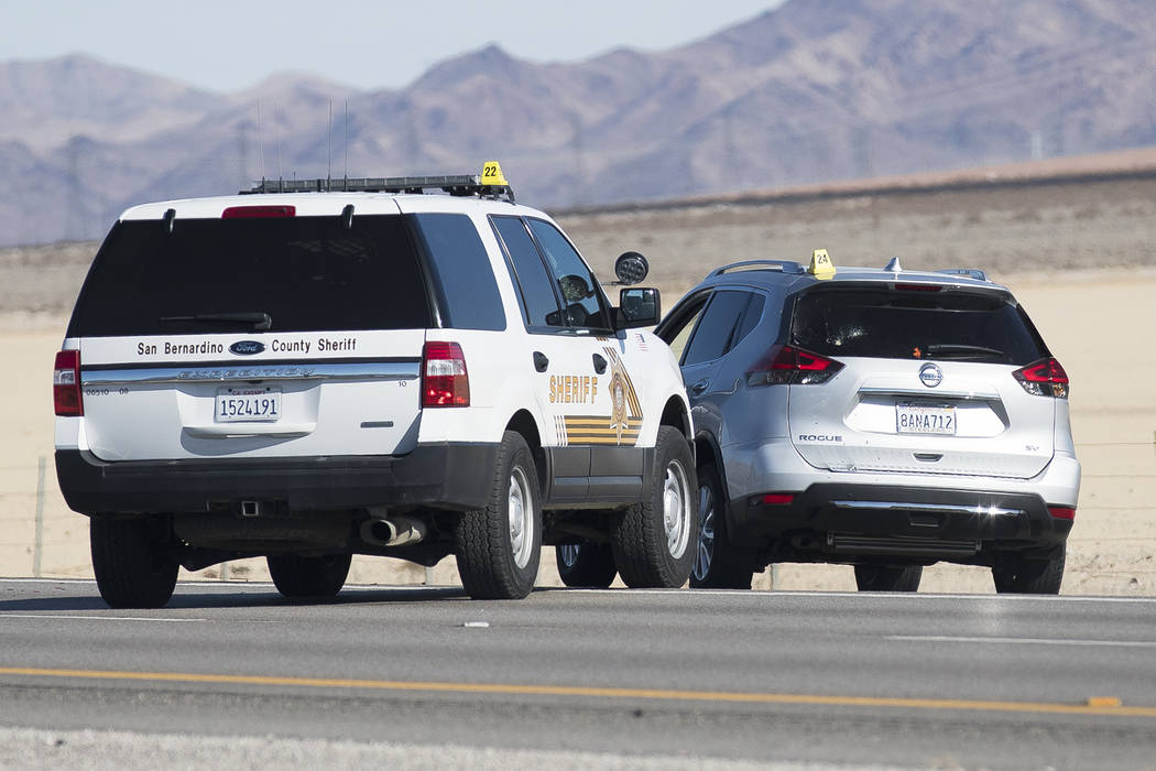 The suspect's car at the scene of a fatal officer-involved shooting south of Primm on northboun ...