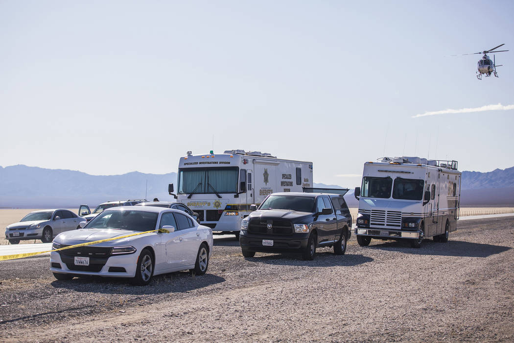 Police work the scene of a fatal officer-involved shooting south of Primm on northbound Interst ...