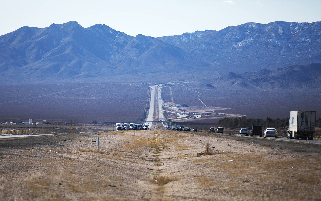 Motorists are stuck on northbound Interstate 15 ahead of where the police are working the scene ...