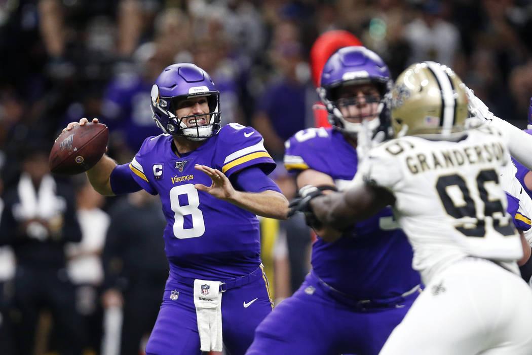 Minnesota Vikings quarterback Kirk Cousins (8) passes under pressure from New Orleans Saints de ...