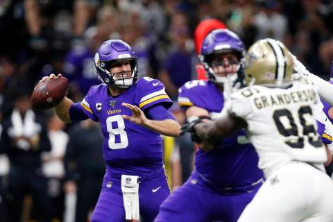 Minnesota Vikings quarterback Kirk Cousins (8) passes under pressure from New Orleans Saints de ...