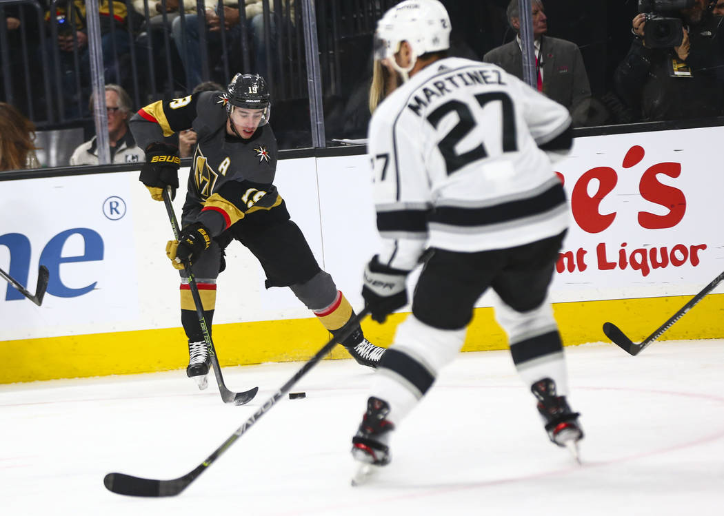 Golden Knights' Reilly Smith (19) moves the puck against the Los Angeles Kings during the first ...