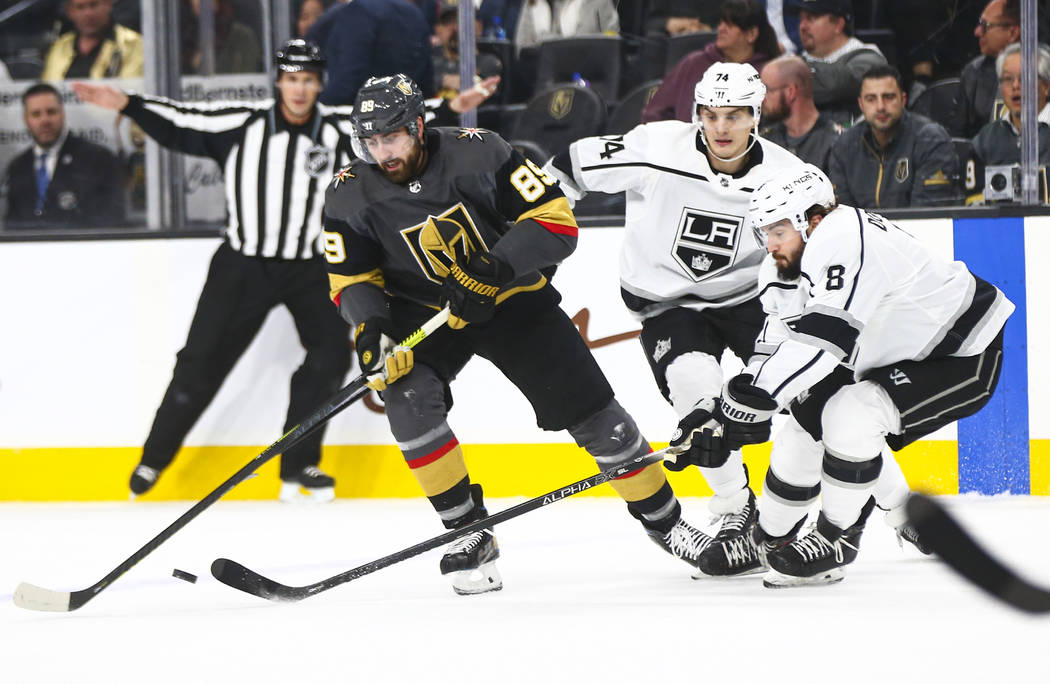 Golden Knights' Alex Tuch (89) battles for the puck against Los Angeles Kings' Nikolai Prokhork ...