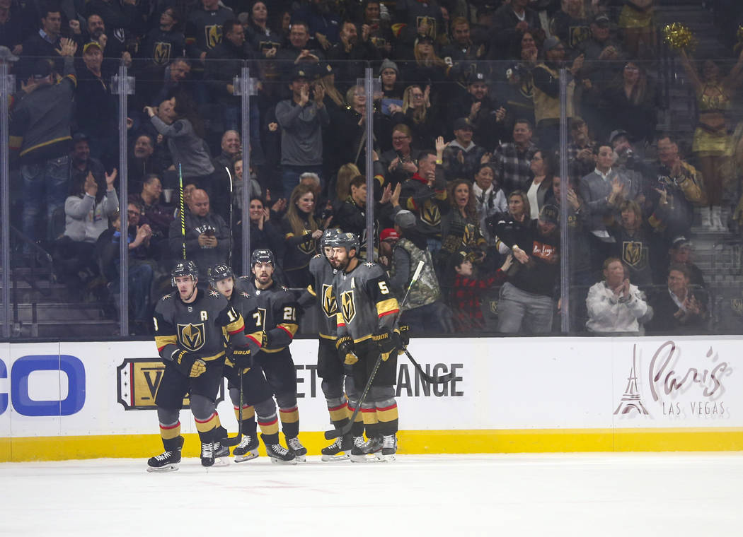 The Golden Knights celebrate goal by Reilly Smith (19) during the second period of an NHL hocke ...