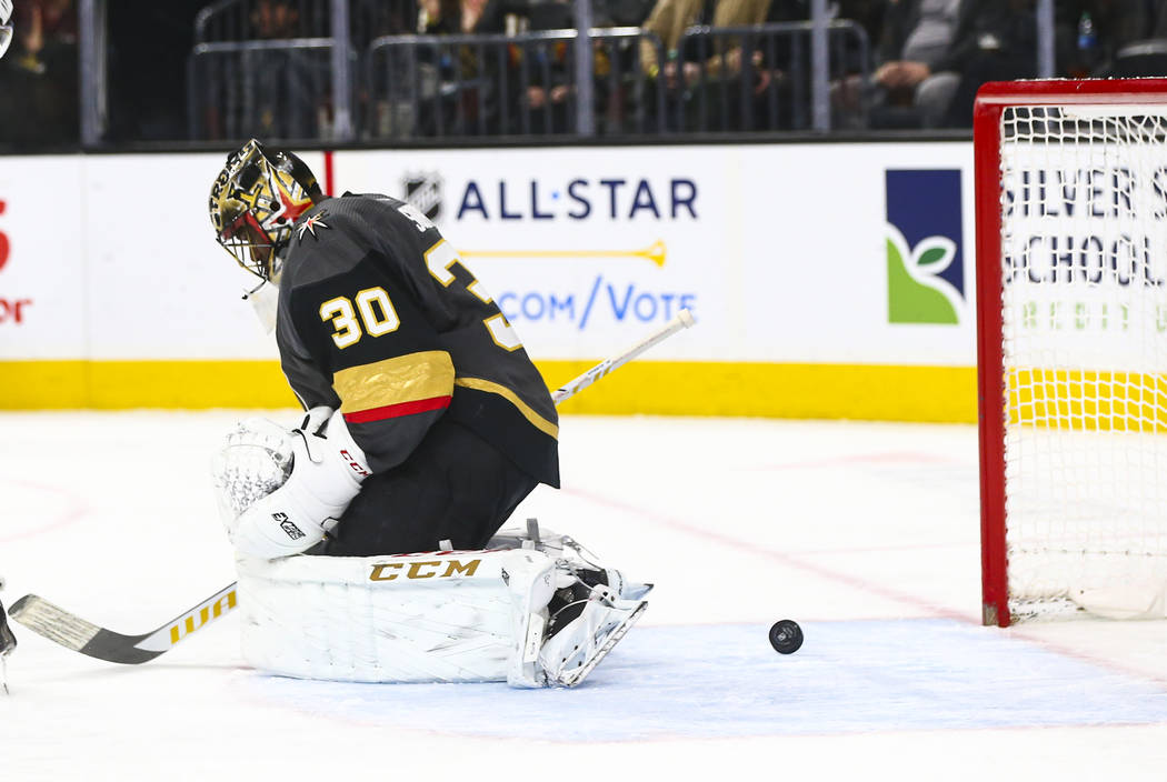 The puck spins around behind Golden Knights goaltender Malcolm Subban (30) during the second pe ...