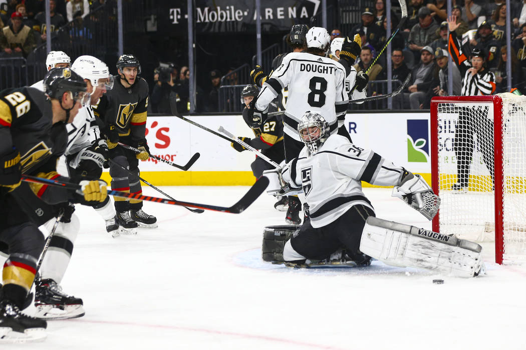Los Angeles Kings goaltender Jack Campbell (36) blocks a shot from the Golden Knights during th ...