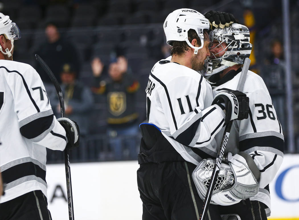 Los Angeles Kings' Anze Kopitar (11) and goaltender Jack Campbell (36) celebrate their team's w ...