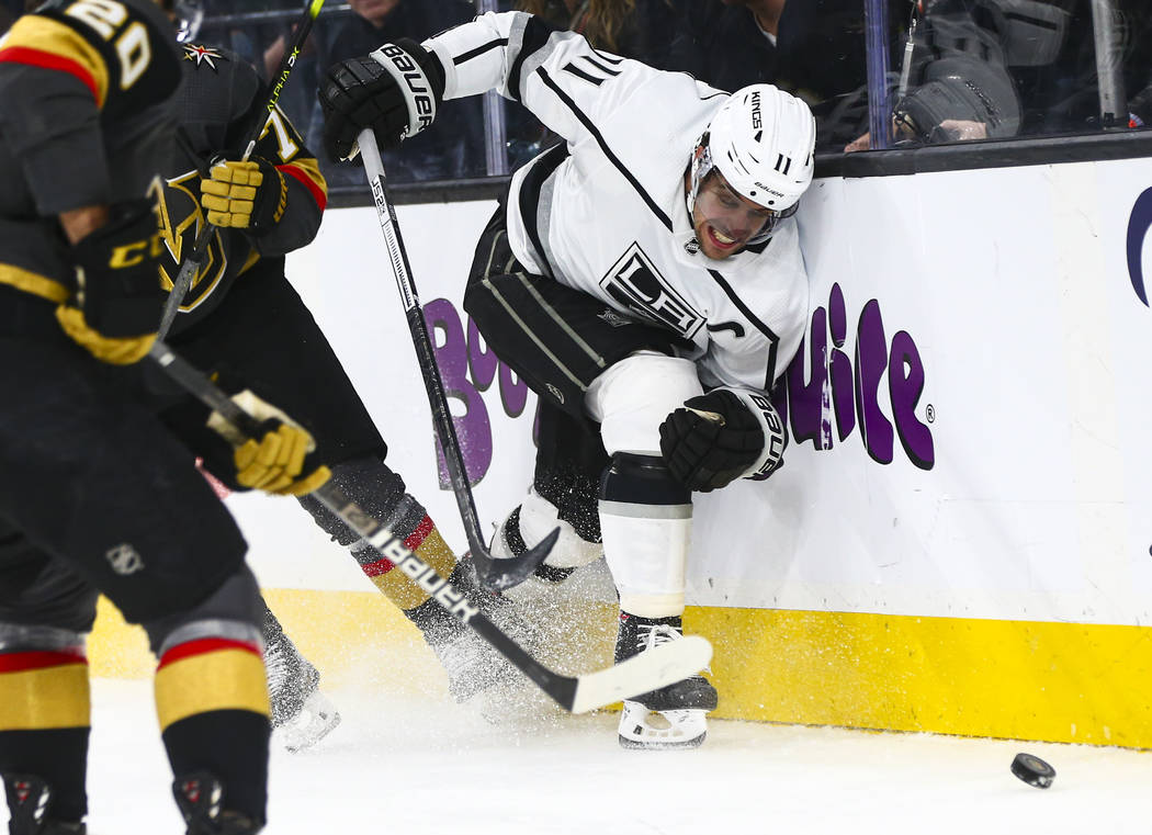Los Angeles Kings' Anze Kopitar (11) chases after the puck against the Golden Knights during th ...