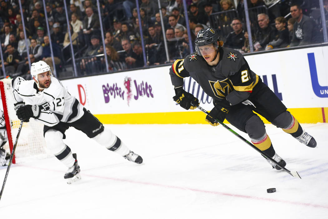 Golden Knights' Cody Eakin (21) skates with the puck against Los Angeles Kings' Alec Martinez ( ...