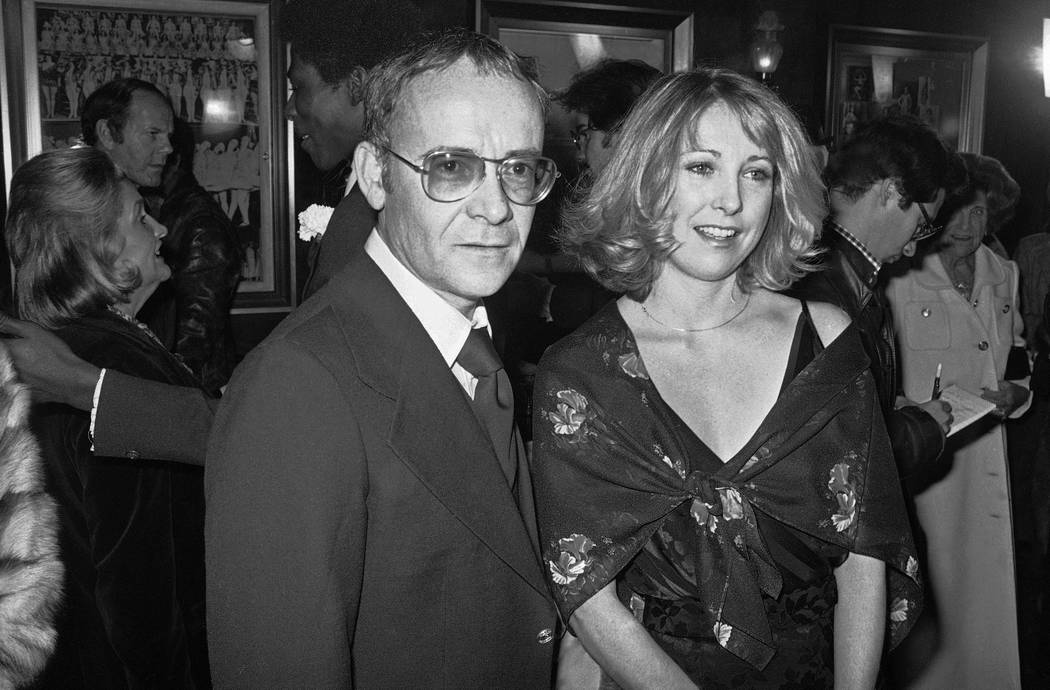 FILE - In this Nov. 15, 1977, file photo, Buck Henry and Teri Garr appear at the opening of the ...