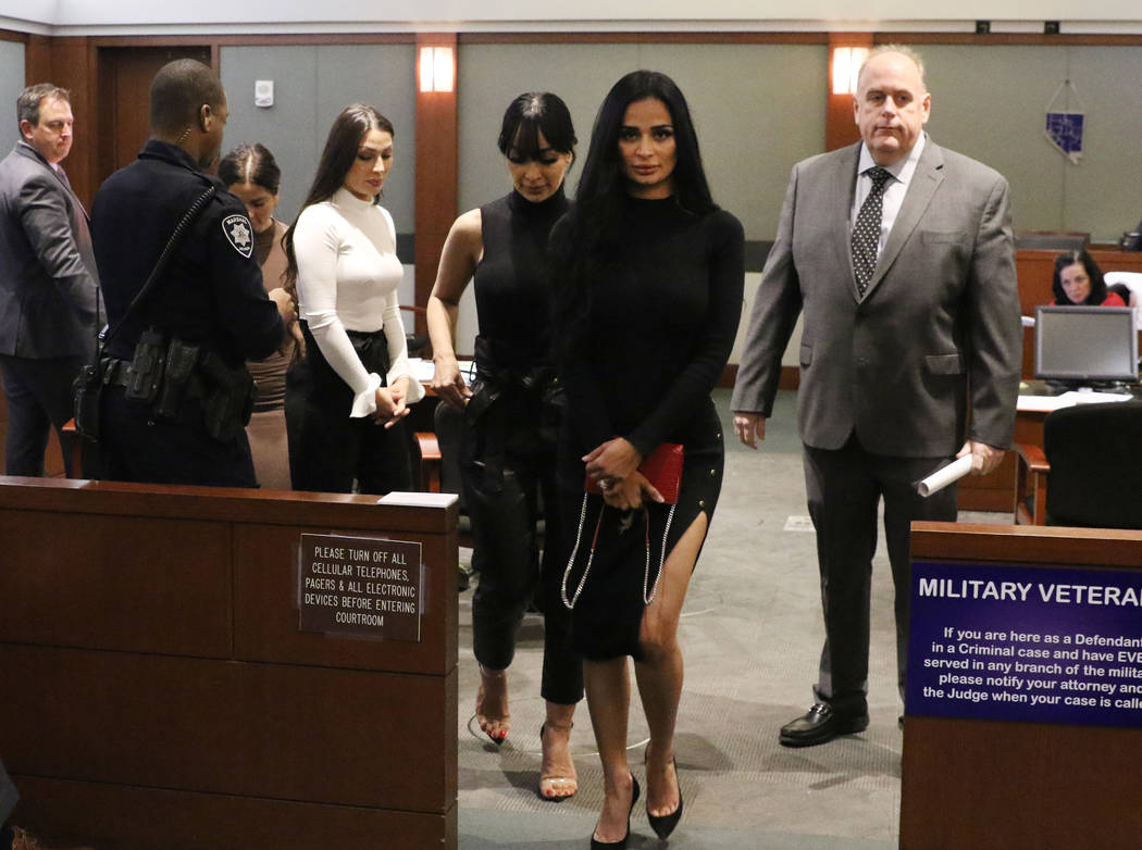 Four women, accused of an attack involving shoes at the Cosmopolitan, leave the courtroom with ...