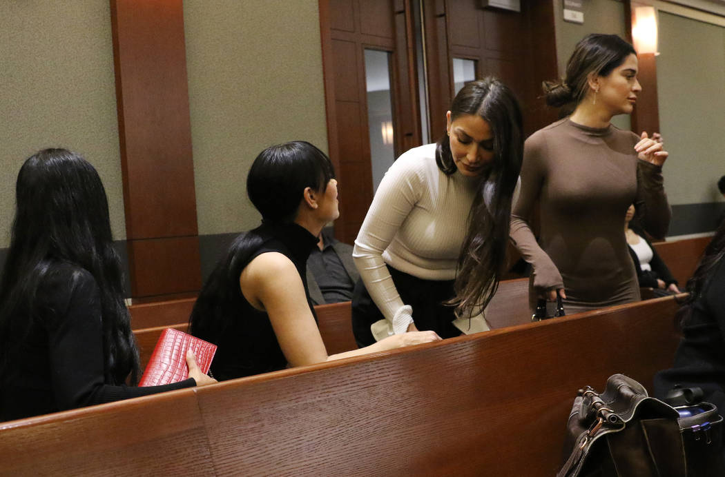 Four women, accused of an attack involving shoes at the Cosmopolitan, enter the courtroom durin ...