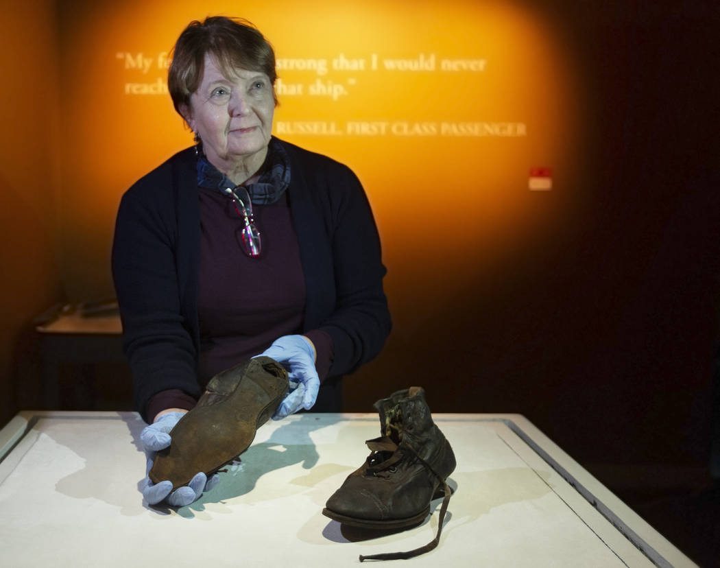 Alexandra Klingelhofer, executive director for collections, holds a pair of dress boots worn by ...