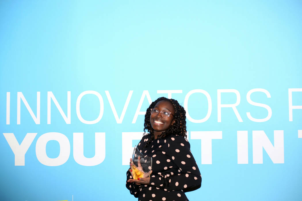 Sofia Ongele, 19, holds her Young Innovators to Watch Scholarship Program award, at the Venetia ...
