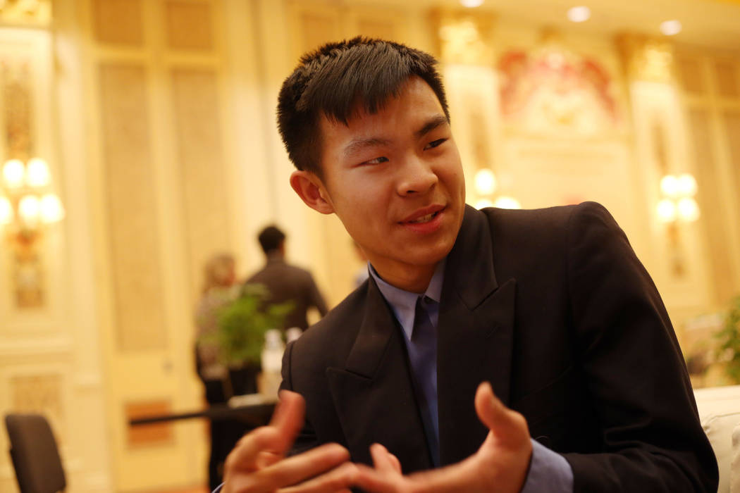 Stanley Liu, 16, winner of a Young Innovators to Watch Scholarship Program award, speaks with a ...