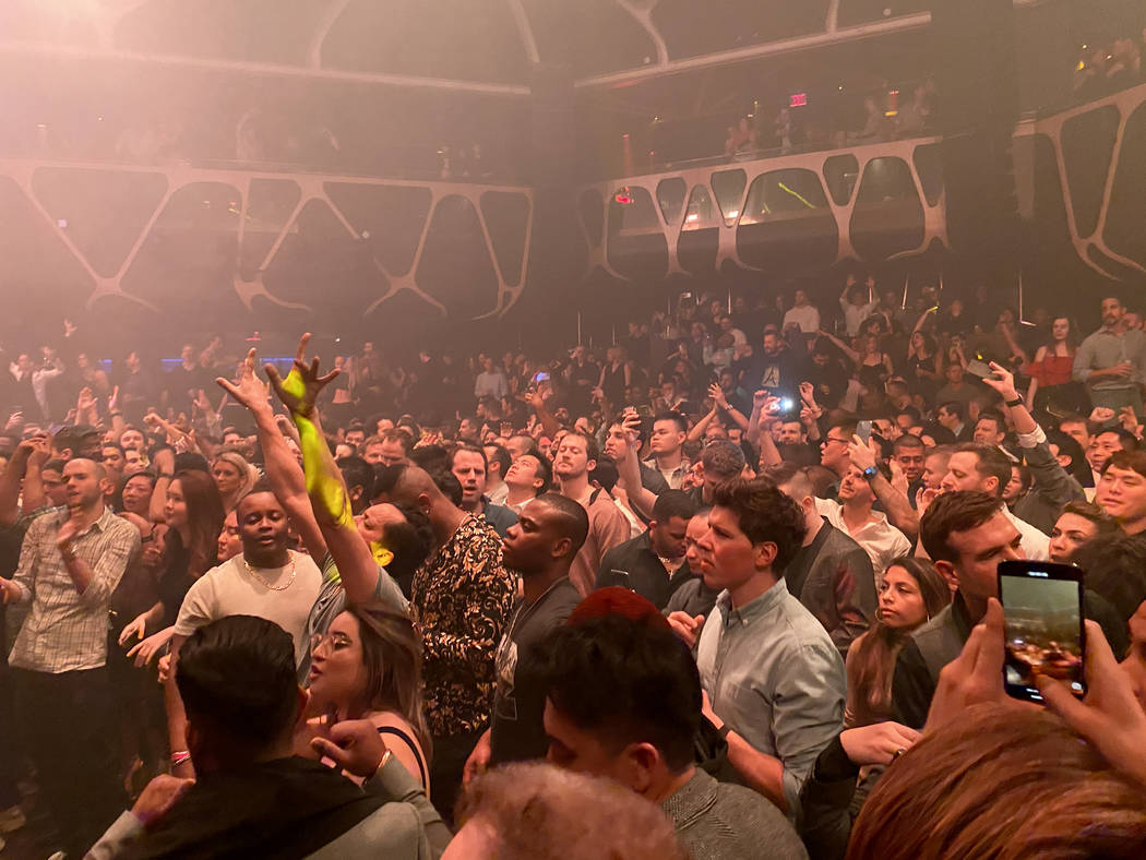 CES conventioneers and clubgoers dance to Tiesto during the DreamlandXR Closing Night Party at ...