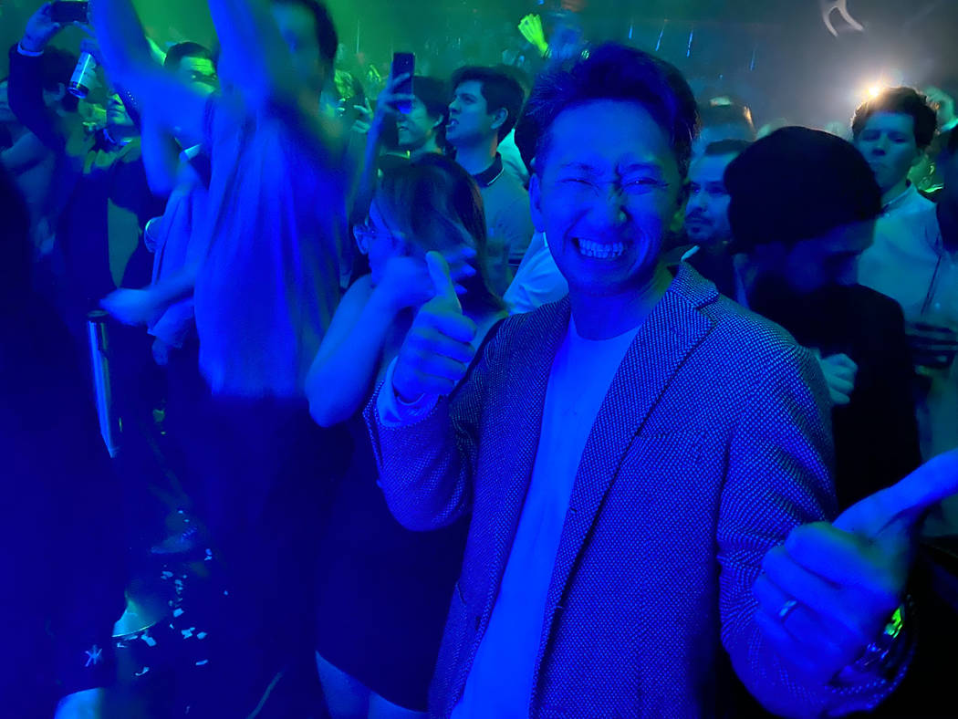 CES conventioneer who declined to give his name dances to Tiesto during the DreamlandXR Closing ...